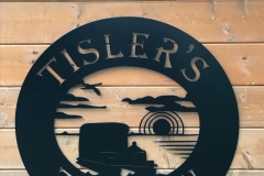 Tisler-Tavern-sign-close-up-on-bar-wall